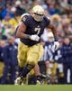 Nov 2, 2013; South Bend, IN, USA; Notre Dame Fighting Irish defensive end Stephon Tuitt (7) plays in the second quarter against the Navy Midshipmen at Notre Dame Stadium. Notre Dame won 38-34. Mandatory Credit: Matt Cashore-USA TODAY Sports