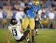 Nov 2, 2013; Pasadena, CA, USA; UCLA Bruins linebacker Anthony Barr (11) is called for a roughing the passer penalty after a hit on Colorado Buffaloes quarterback Sefo Liufau (13) at Rose Bowl. UCLA defeated Colorado 45-23. Mandatory Credit: Kirby Lee-USA TODAY Sports
