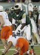 Nov 2, 2013; Fort Collins, CO, USA; Colorado State Rams linebacker Shaquil Barrett (56) goes over Boise State Broncos offensive lineman Eli McCullough (75) during the second quarter at Hughes Stadium. The Broncos defeated the Rams 42-30. Mandatory Credit: Troy Babbitt-USA TODAY Sports