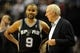 Nov 2, 2013; Portland, OR, USA; San Antonio Spurs point guard Tony Parker (9) speaks with head coach Gregg Popovich during the fourth quarter of the game against the Portland Trail Blazers at the Moda Center. The Blazers won the game 115-105. Mandatory Credit: Steve Dykes-USA TODAY Sports