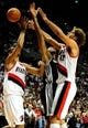Nov 2, 2013; Portland, OR, USA; Portland Trail Blazers small forward Nicolas Batum (88), San Antonio Spurs power forward Tim Duncan (21) and Portland Trail Blazers center Robin Lopez (42) battle for a rebound during the fourth quarter of the game at  the Moda Center. The Blazers won the game 115-105. Mandatory Credit: Steve Dykes-USA TODAY Sports