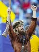 Nov 2, 2013; Fort Worth, TX, USA; West Virginia Mountaineers mascot the Mountaineer during the game against the TCU Horned Frogs at Amon G. Carter Stadium. West Virginia won 30-27. Mandatory Credit: Kevin Jairaj-USA TODAY Sports