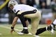 Nov 3, 2013; East Rutherford, NJ, USA; New Orleans Saints quarterback Drew Brees (9) picks himself up off the ground against the New York Jets during the second half at MetLife Stadium. The Jets won the game 26-20. Mandatory Credit: Joe Camporeale-USA TODAY Sports