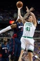 Nov 3, 2013; Auburn Hills, MI, USA; Detroit Pistons small forward Josh Smith (6) and Boston Celtics power forward Kelly Olynyk (41) during the second quarter at The Palace of Auburn Hills. Mandatory Credit: Tim Fuller-USA TODAY Sports