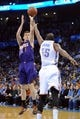 Nov 3, 2013; Oklahoma City, OK, USA; Phoenix Suns point guard Goran Dragic (1) attempts a shot while being guarded by Oklahoma City Thunder small forward Kevin Durant (35) during the first quarter at Chesapeake Energy Arena. Mandatory Credit: Mark D. Smith-USA TODAY Sports