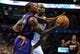 Nov 3, 2013; Oklahoma City, OK, USA; Phoenix Suns point guard Eric Bledsoe (2) handles the ball while guarded by Oklahoma City Thunder center Kendrick Perkins (5) during the first quarter at Chesapeake Energy Arena. Mandatory Credit: Mark D. Smith-USA TODAY Sports