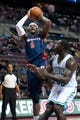 Nov 3, 2013; Auburn Hills, MI, USA; Detroit Pistons small forward Josh Smith (6) shoots over Boston Celtics power forward Brandon Bass (30) during the third quarter at The Palace of Auburn Hills. Detroit won 87-77. Mandatory Credit: Tim Fuller-USA TODAY Sports
