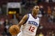 Oct 23, 2013; Philadelphia, PA, USA; Philadelphia 76ers guard Evan Turner (12) during the third quarter against the Minnesota Timberwolves at Wells Fargo Center. The Timberwolves defeated the Sixers 125-102. Mandatory Credit: Howard Smith-USA TODAY Sports