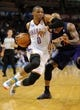Nov 3, 2013; Oklahoma City, OK, USA; Oklahoma City Thunder point guard Russell Westbrook (0) handles the ball against Phoenix Suns small forward P.J. Tucker (17) during the third quarter at Chesapeake Energy Arena. Mandatory Credit: Mark D. Smith-USA TODAY Sports