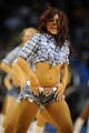 Nov 3, 2013; Oklahoma City, OK, USA; A member of the Oklahoma City Thunder dance team entertains the crowd in a break in action against the Phoenix Suns at Chesapeake Energy Arena. Mandatory Credit: Mark D. Smith-USA TODAY Sports