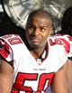 Nov 3, 2013; Charlotte, NC, USA; Atlanta Falcons defensive end Osi Umenyiora (50) on the sidelines in the fourth quarter. The Panthers defeated the Falcons 34-10 at Bank of America Stadium. Mandatory Credit: Bob Donnan-USA TODAY Sports