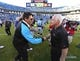 Nov 3, 2013; Charlotte, NC, USA; Carolina Panthers head coach Ron Rivera with Atlanta Falcons head coach Mike Smith after the game. The Panthers defeated the Falcons 34-10 at Bank of America Stadium. Mandatory Credit: Bob Donnan-USA TODAY Sports