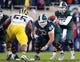 Nov 2, 2013; East Lansing, MI, USA;Michigan State Spartans quarterback Connor Cook (18) takes the snap of the ball from offensive linesman Jack Allen (66) during the 2nd half of a game against the Michigan Wolverines at Spartan Stadium. MSU won 29-6. Mandatory Credit: Mike Carter-USA TODAY Sports