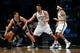 Nov 5, 2013; Brooklyn, NY, USA;  Utah Jazz center Enes Kanter (0) looks to drive past Brooklyn Nets center Brook Lopez (11) and point guard Deron Williams (8) during the first quarter at Barclays Center. Mandatory Credit: Anthony Gruppuso-USA TODAY Sports