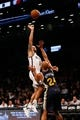Nov 5, 2013; Brooklyn, NY, USA;  Brooklyn Nets point guard Deron Williams (8) shoots over Utah Jazz small forward Richard Jefferson (24) during the first quarter at Barclays Center. Mandatory Credit: Anthony Gruppuso-USA TODAY Sports