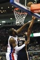 Nov 5, 2013; Auburn Hills, MI, USA; Indiana Pacers power forward David West (21) attempts a shot while defended by Detroit Pistons center Greg Monroe (10) during the third quarter at The Palace of Auburn Hills. The Pacers beat the Pistons 99-91. Mandatory Credit: Raj Mehta-USA TODAY Sports