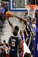 Nov 5, 2013; Auburn Hills, MI, USA; Detroit Pistons point guard Brandon Jennings (7) is blocked by Indiana Pacers center Roy Hibbert (55) during the third fourth quarter at The Palace of Auburn Hills. The Pacers beat the Pistons 99-91. Mandatory Credit: Raj Mehta-USA TODAY Sports