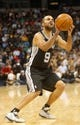 Nov 5, 2013; Denver, CO, USA; San Antonio Spurs guard Tony Parker (9) prepares to shoo the ball during the second half against the Denver Nuggets at Pepsi Center. The Spurs won 102-94. Mandatory Credit: Chris Humphreys-USA TODAY Sports