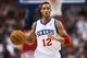 Nov 4, 2013; Philadelphia, PA, USA; Philadelphia 76ers guard Evan Turner (12) brings the ball up court during the third quarter against the Golden State Warriors at Wells Fargo Center. The Warriors defeated the Sixers 110-90. Mandatory Credit: Howard Smith-USA TODAY Sports