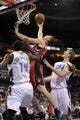 Nov 6, 2013; Charlotte, NC, USA; Toronto Raptors forward Tyler Hansbrough (50) drives to the basket as he is defended by Charlotte Bobcats forward Michael Kidd-Gilchrist (14) and forward Cody Zeller (40) during the game at Time Warner Cable Arena. Mandatory Credit: Sam Sharpe-USA TODAY Sports