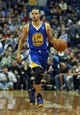 Nov 6, 2013; Minneapolis, MN, USA; Golden State Warriors point guard Stephen Curry (30) dribbles the ball down the court in the first half against the Minnesota Timberwolves at Target Center. Mandatory Credit: Jesse Johnson-USA TODAY Sports