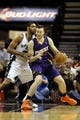Nov 6, 2013; San Antonio, TX, USA; Phoenix Suns  forward Miles Plumlee (22) posts up against San Antonio Spurs forward Tim Duncan (left) during the first half at AT&T Center. Mandatory Credit: Soobum Im-USA TODAY Sports