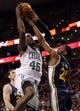Nov 6, 2013; Boston, MA, USA; Boston Celtics small forward Gerald Wallace (45) drives the ball against Utah Jazz shooting guard Ian Clark (21) in the second half at TD Garden. The Celtics defeated the Jazz 97-87. Mandatory Credit: David Butler II-USA TODAY Sports