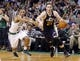 Nov 6, 2013; Boston, MA, USA; Utah Jazz small forward Gordon Hayward (20) drives the ball against Boston Celtics point guard Avery Bradley (0) in the second half at TD Garden. The Celtics defeated the Jazz 97-87. Mandatory Credit: David Butler II-USA TODAY Sports