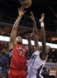 Nov 6, 2013; Charlotte, NC, USA; Toronto Raptors forward Rudy Gay (22) drives to the basket as he is defended by Charlotte Bobcats forward Michael Kidd-Gilchrist (14) during the game at Time Warner Cable Arena. Mandatory Credit: Sam Sharpe-USA TODAY Sports