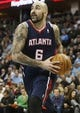 Nov 7, 2013; Denver, CO, USA;  Atlanta Hawks center Pero Antic (6) drives to the basket during the second half against the Denver Nuggets at Pepsi Center. The Nuggets won 109-107. Mandatory Credit: Chris Humphreys-USA TODAY Sports