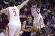 Nov 7, 2013; Houston, TX, USA; Los Angeles Lakers point guard Steve Nash (10) drives against Houston Rockets center Omer Asik (3) and point guard Patrick Beverley (2) during the second half at Toyota Center. The Lakers won 99-98. Mandatory Credit: Thomas Campbell-USA TODAY Sports