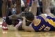 Nov 7, 2013; Houston, TX, USA; Houston Rockets point guard Patrick Beverley (2) grabs his face after colliding with Los Angeles Lakers point guard Steve Nash (10) during the second half at Toyota Center. The Lakers won 99-98. Mandatory Credit: Thomas Campbell-USA TODAY Sports