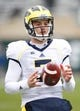 Nov 2, 2013; East Lansing, MI, USA; Michigan Wolverines quarterback Shane Morris (7) warms up before the game against the Michigan State Spartans at Spartan Stadium. The Spartans beat the Wolverines 29-6. Mandatory Credit: Raj Mehta-USA TODAY Sports
