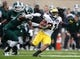 Nov 2, 2013; East Lansing, MI, USA; Michigan Wolverines wide receiver Jeremy Gallon (21) runs with the ball during the first quarter against the Michigan State Spartans at Spartan Stadium. The Spartans beat the Wolverines 29-6. Mandatory Credit: Raj Mehta-USA TODAY Sports