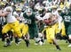 Nov 2, 2013; East Lansing, MI, USA; Michigan Wolverines running back Fitzgerald Toussaint (28) runs the ball during the first quarter against the Michigan State Spartans at Spartan Stadium. The Spartans beat the Wolverines 29-6. Mandatory Credit: Raj Mehta-USA TODAY Sports