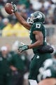 Nov 2, 2013; East Lansing, MI, USA; Michigan State Spartans wide receiver Bennie Fowler (13) makes a one handed catch during the first quarter against the Michigan Wolverines at Spartan Stadium. The Spartans beat the Wolverines 29-6. Mandatory Credit: Raj Mehta-USA TODAY Sports