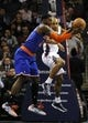 Nov 8, 2013; Charlotte, NC, USA; New York Knicks guard forward Iman Shumpert (21) and Charlotte Bobcats guard Gerald Henderson (9) fight for a rebound during the game at Time Warner Cable Arena. Mandatory Credit: Sam Sharpe-USA TODAY Sports
