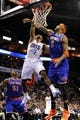 Nov 8, 2013; Charlotte, NC, USA; Charlotte Bobcats guard Ramon Sessions (7) drives to the basket and scores as he is defended New York Knicks forward Kenyon Martin (3) by during the game at Time Warner Cable Arena. Knicks win 101-91. Mandatory Credit: Sam Sharpe-USA TODAY Sports