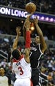 Nov 8, 2013; Washington, DC, USA; Brooklyn Nets shooting guard Joe Johnson (7) shoots over Washington Wizards shooting guard Bradley Beal (3) during the second half at the Verizon Center. The Wizards defeated the Nets 112 - 108. Mandatory Credit: Brad Mills-USA TODAY Sports