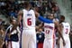 Nov 8, 2013; Auburn Hills, MI, USA; Detroit Pistons point guard Will Bynum (12) high fives small forward Josh Smith (6) during the fourth quarter against the Oklahoma City Thunder at The Palace of Auburn Hills. Mandatory Credit: Tim Fuller-USA TODAY Sports