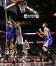 Nov 8, 2013; San Antonio, TX, USA; Golden State Warriors forward David Lee (left) drives to the basket as San Antonio Spurs forward Tim Duncan (right) defends during the second half at AT&T Center. The Spurs won 76-74. Mandatory Credit: Soobum Im-USA TODAY Sports