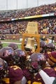 Nov 9, 2013; Minneapolis, MN, USA; Minnesota Gopher players hold up the Governor's Victory Bell trophy after their win against the Penn State Nittany Lions at TCF Bank Stadium. Minnesota wins 24-10. Mandatory Credit: Brad Rempel-USA TODAY Sports