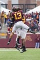 Nov 9, 2013; Minneapolis, MN, USA; Minnesota Gophers defensive back Derrick Wells (13) celebrates a fumble recovery in the fourth quarter against the Penn State Nittany Lions at TCF Bank Stadium. Minnesota wins 24-10. Mandatory Credit: Brad Rempel-USA TODAY Sports
