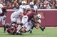 Nov 9, 2013; Minneapolis, MN, USA; Penn State Nittany Lions running back Zach Zwinak (28) gets tackled by the Minnesota Gophers team in the fourth quarter at TCF Bank Stadium. Minnesota wins 24-10. Mandatory Credit: Brad Rempel-USA TODAY Sports