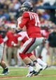 Nov 9, 2013; Oxford, MS, USA; Mississippi Rebels quarterback Bo Wallace (14) drops back for a pass during the game against the Arkansas Razorbacks at Vaught-Hemingway Stadium. Mississippi Rebels defeat the Arkansas Razorbacks with a score of 34-24.  Mandatory Credit: Spruce Derden-USA TODAY Sports