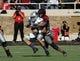 Nov 9, 2013; Lubbock, TX, USA; Texas Tech Red Raiders defensive line backer Pete Robertson (10) sacks Kansas State Wildcats quarterback Jake Waters (15) in the first half at Jones AT&T Stadium. Mandatory Credit: Michael C. Johnson-USA TODAY Sports