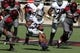 Nov 9, 2013; Lubbock, TX, USA; Kansas State Wildcats running back John Hubert (33) reverses his field against the Texas Tech Red Raiders in the first half at Jones AT&T Stadium. Mandatory Credit: Michael C. Johnson-USA TODAY Sports