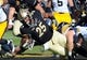Nov 9, 2013; West Lafayette, IN, USA;  Purdue Boilermakers running back Brandon Cottom (25) dives for extra yards against the Iowa Hawkeyes at Ross Ade Stadium. Mandatory Credit: Sandra Dukes-USA TODAY Sports