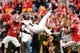 Nov 9, 2013; Athens, GA, USA; Appalachian State Mountaineers wide receiver Tony Washington (15) flies in the air after making a catch and being tackled by Georgia Bulldogs safety Tray Matthews (28) (out of frame) during the second half at Sanford Stadium. Georgia defeated Appalachian State 45-6. Mandatory Credit: Dale Zanine-USA TODAY Sports