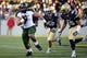 Nov 9, 2013; Annapolis, MD, USA; Hawaii Warriors running back Joey Iosefa (7) runs with the ball during the first quarter of the Hawaii Warriors vs Navy Midshipmen game at Navy Marine Corps Memorial Stadium. Mandatory Credit: Tommy Gilligan-USA TODAY Sports